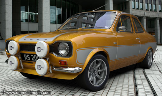 Escort RS2000 in yellow with contrasting silver RS stripes, sitting on Minilite wheels with polished rims