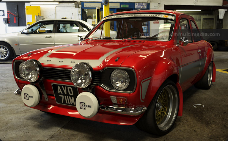 Escort MK1 RS2000 in Red with dark gey stripes, in the Garage